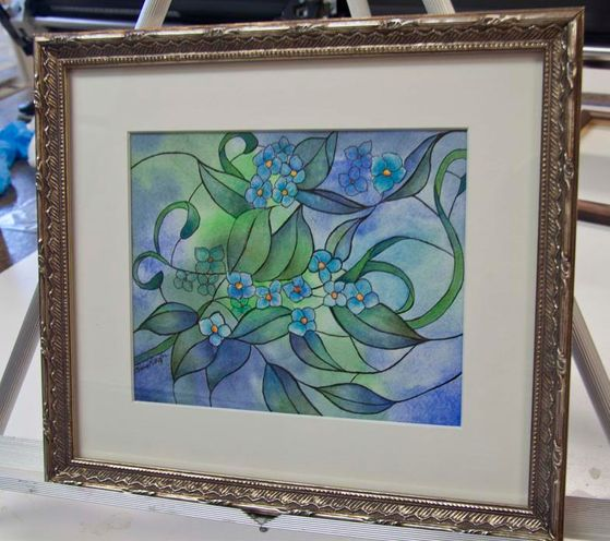A Laura Leeder painting of beautiful blue hues, offset by a whimsical antique silver frame.